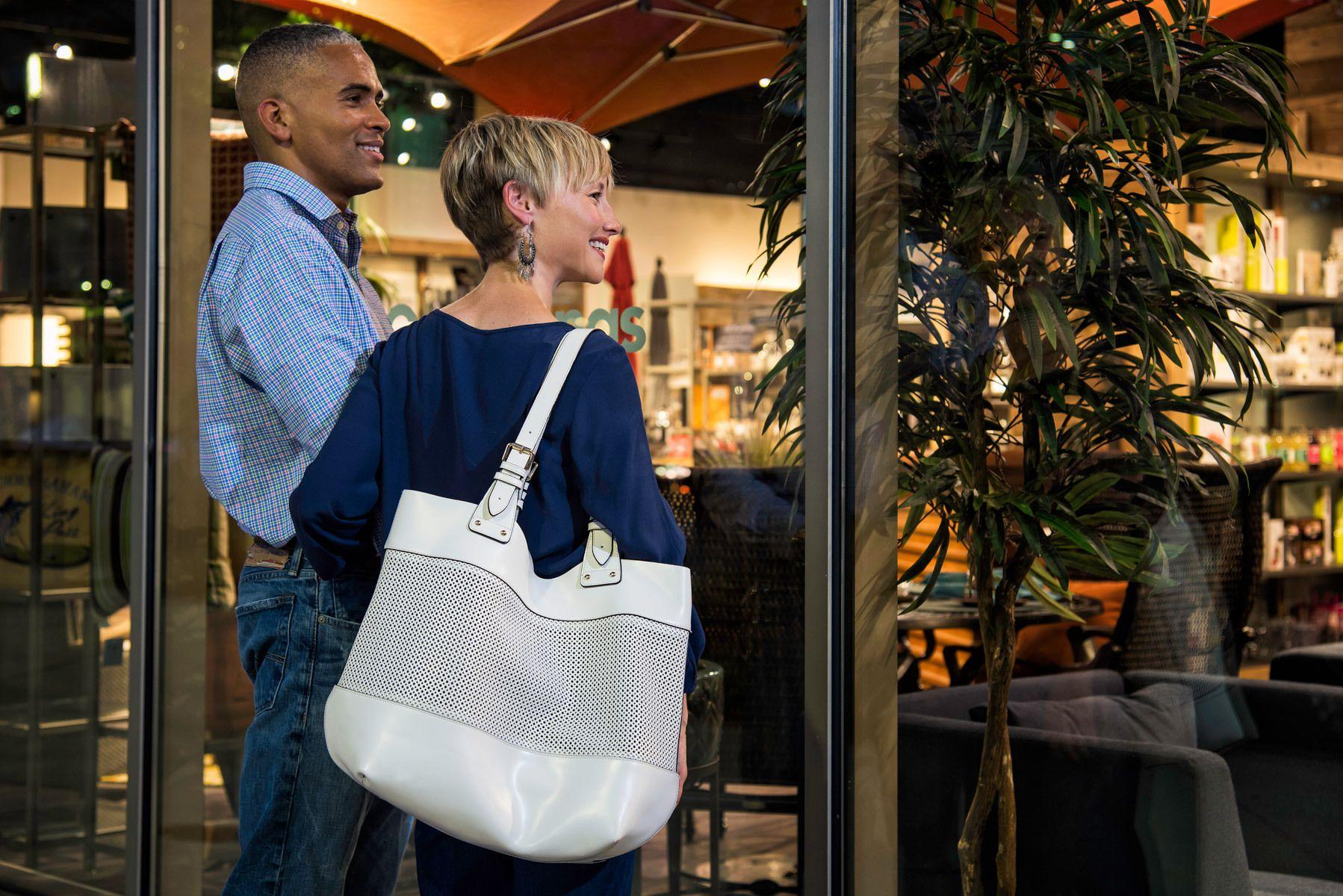 Bi-racial Couple window shopping