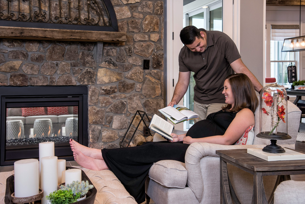 Pregnant woman and husband in living room