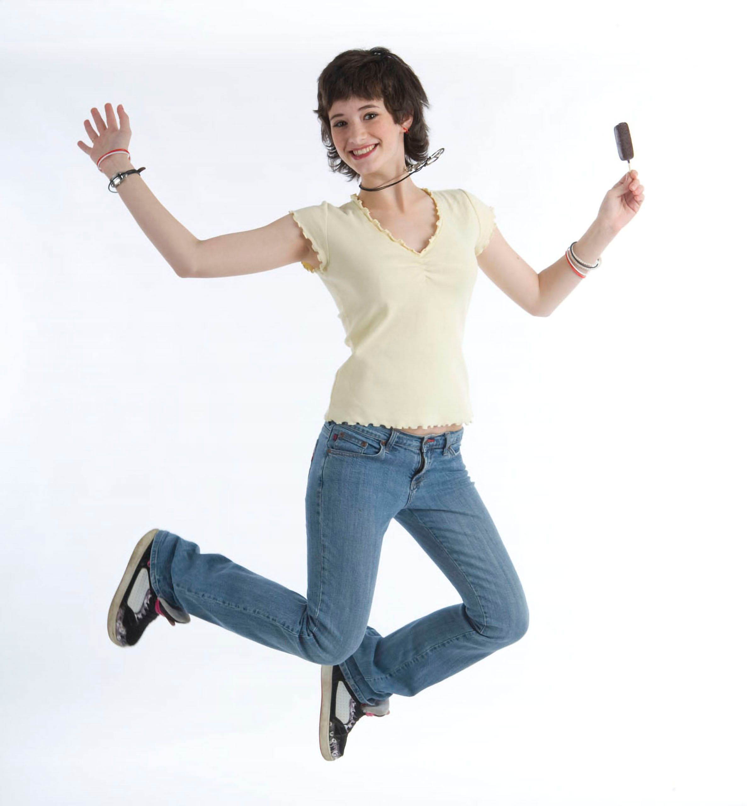 Commercial studio advertising photoshoot young woman  model jumping  for joy