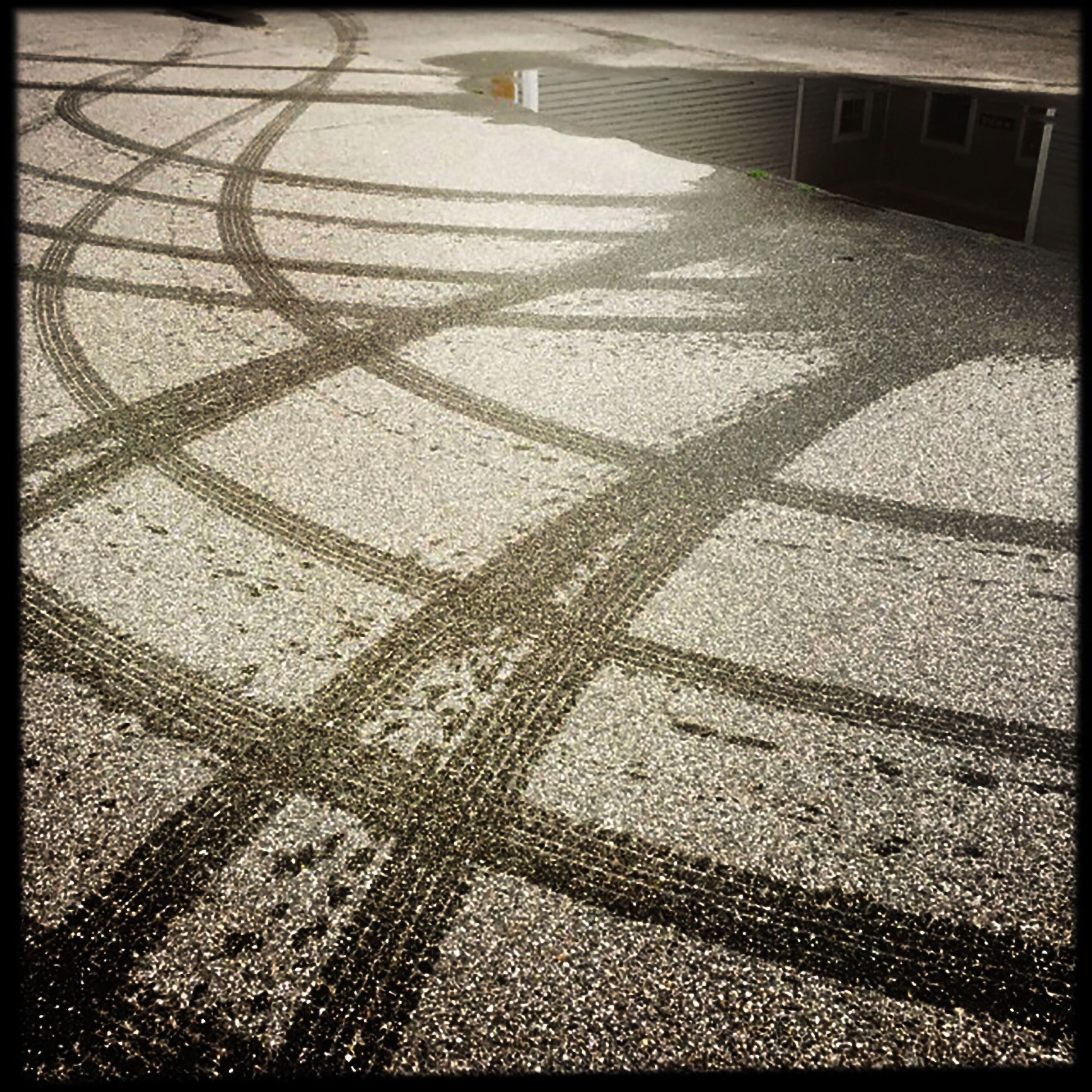 serpentine tire tracks  in street at warren roos photo studio south Portland Maine