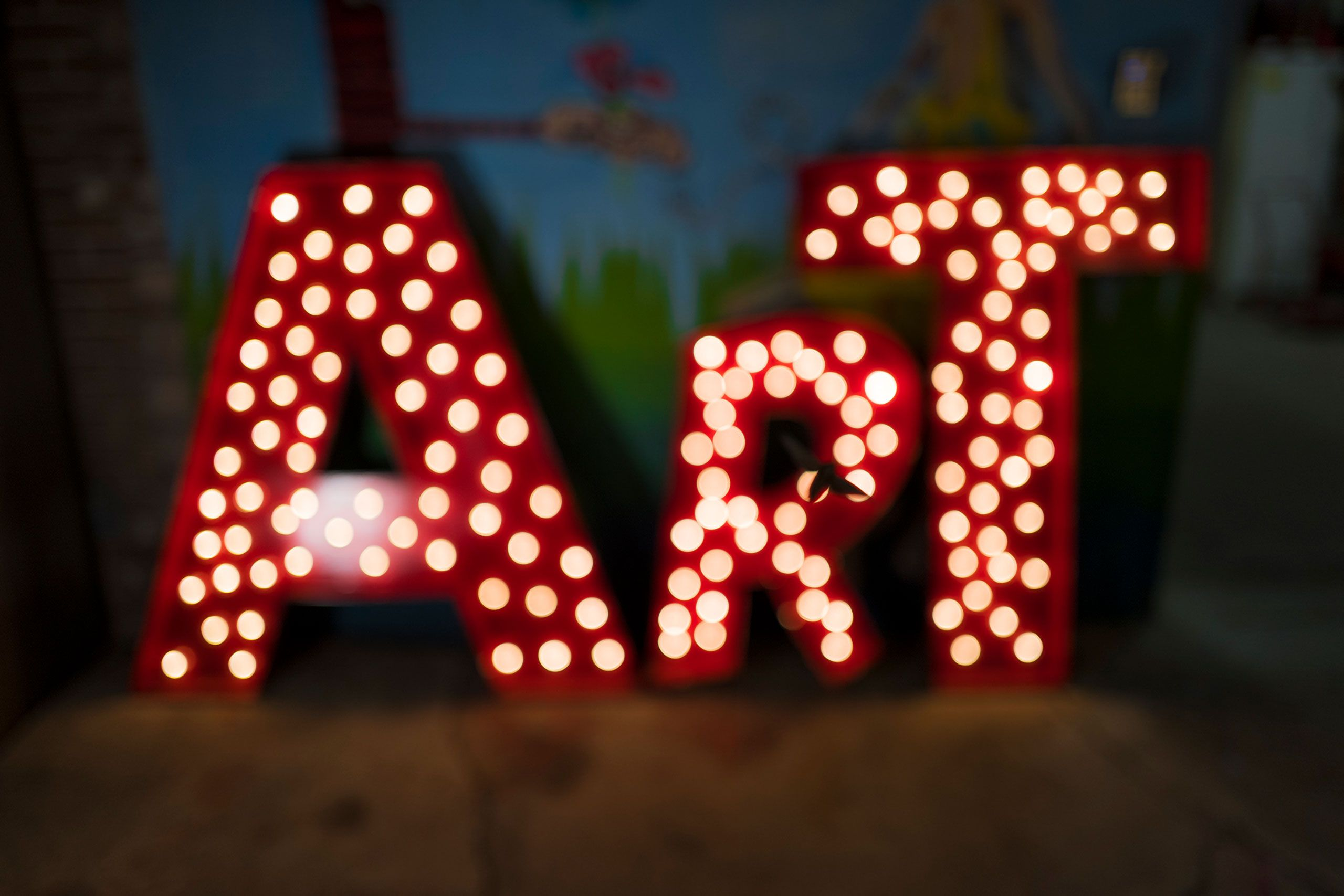 Art sign at night time flee market on  on Frenchmen Street in New  Orleans