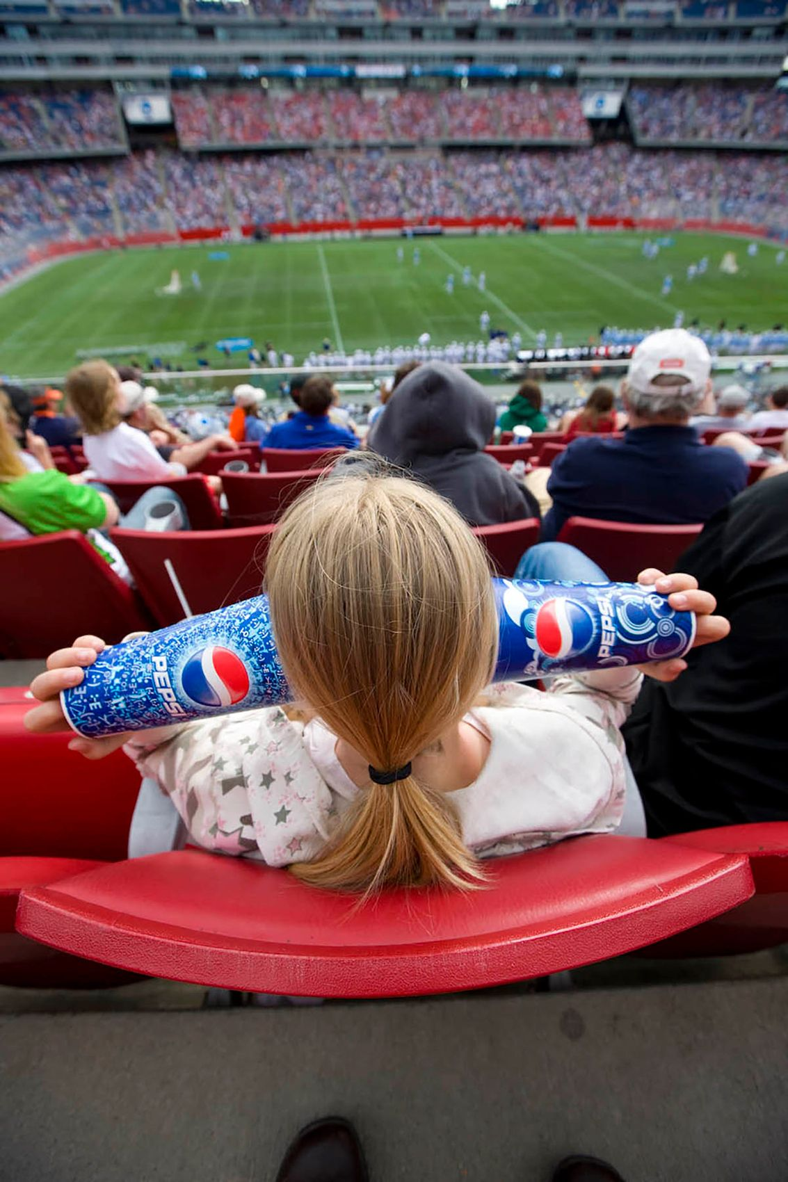 Girl bored at NCAA Men's lacrosse puts cups over her ears