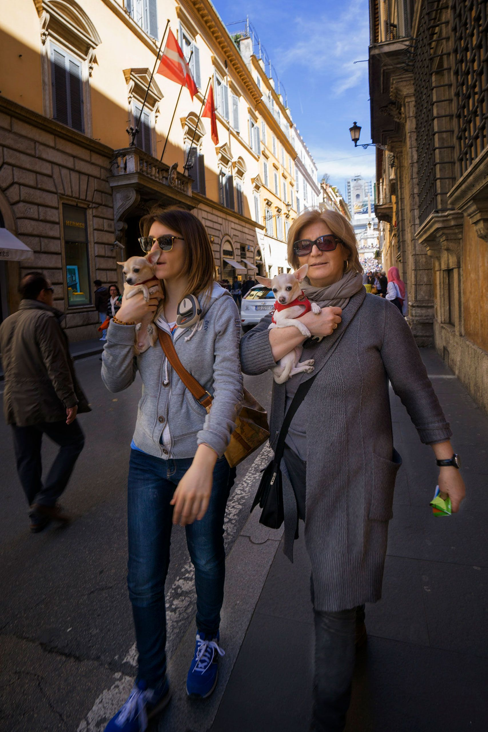 mother and daughter carrying their dogs Rome Italy