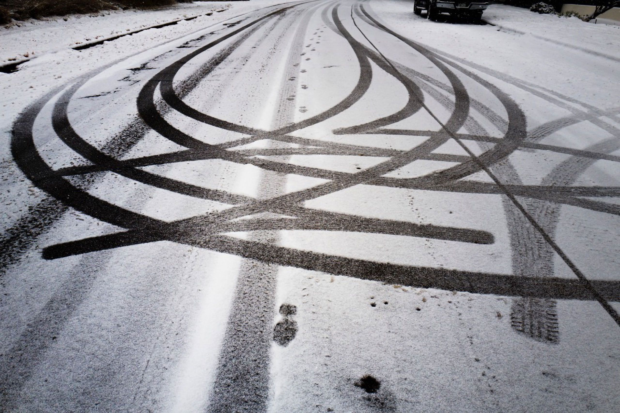 glowing B&W photo of tire tracks in snow boulder Colorado