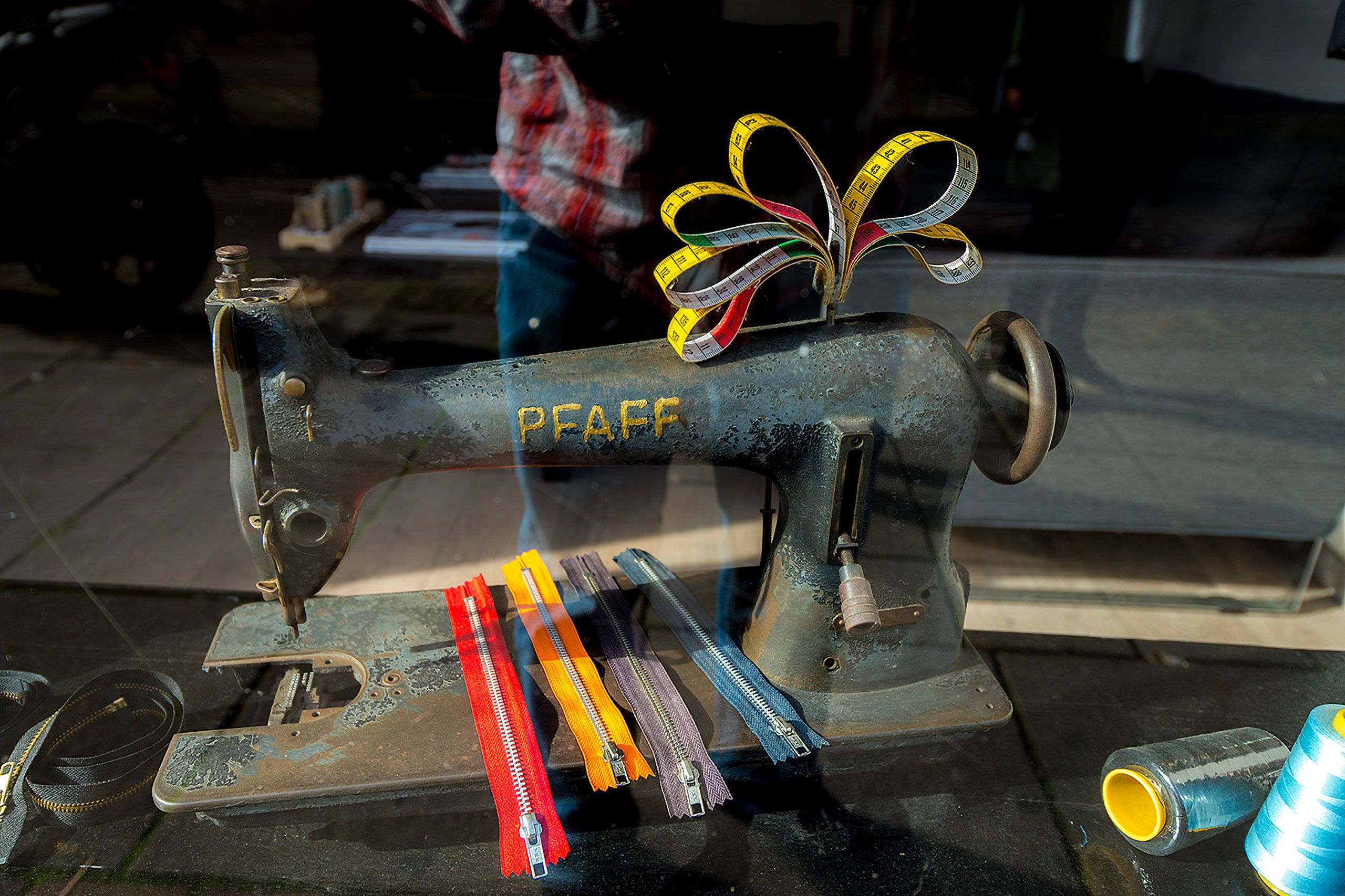PFAFF Sewing machine and new zippers in shop window in Amsterdam