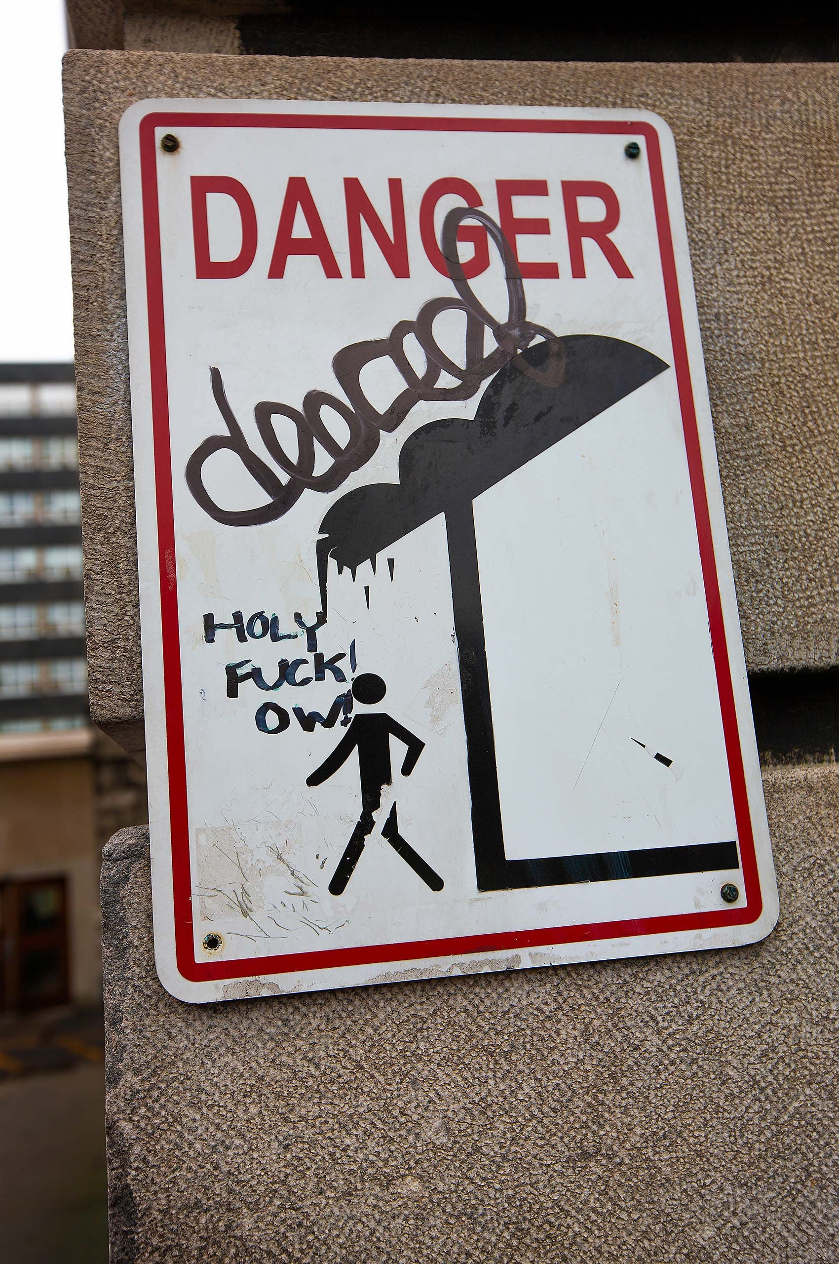 Graffiti at it's best Danger warning. Holy fuck ouh waring for falling ice and water