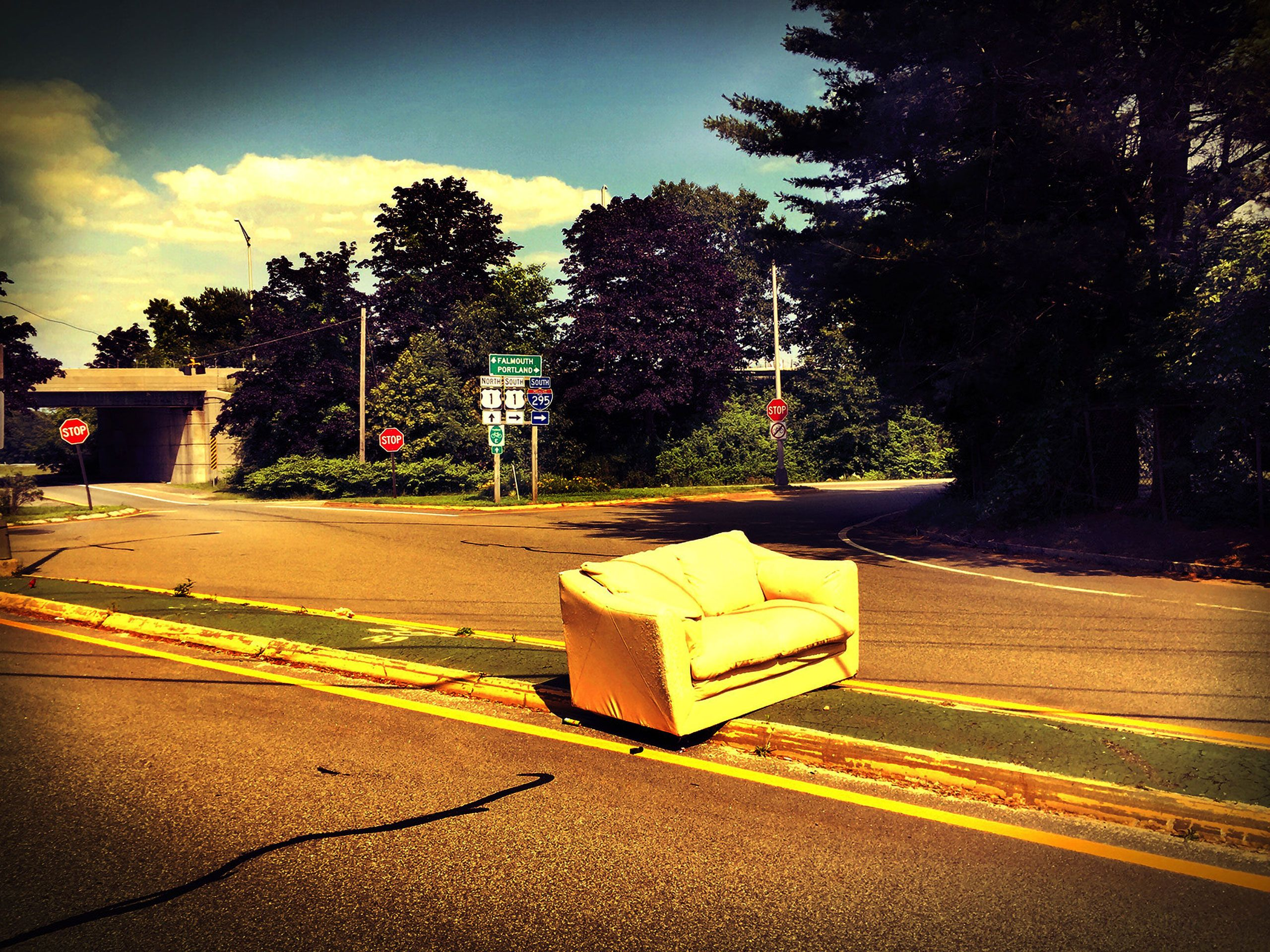 couch in middle of road Portland Maine rt 95 in black