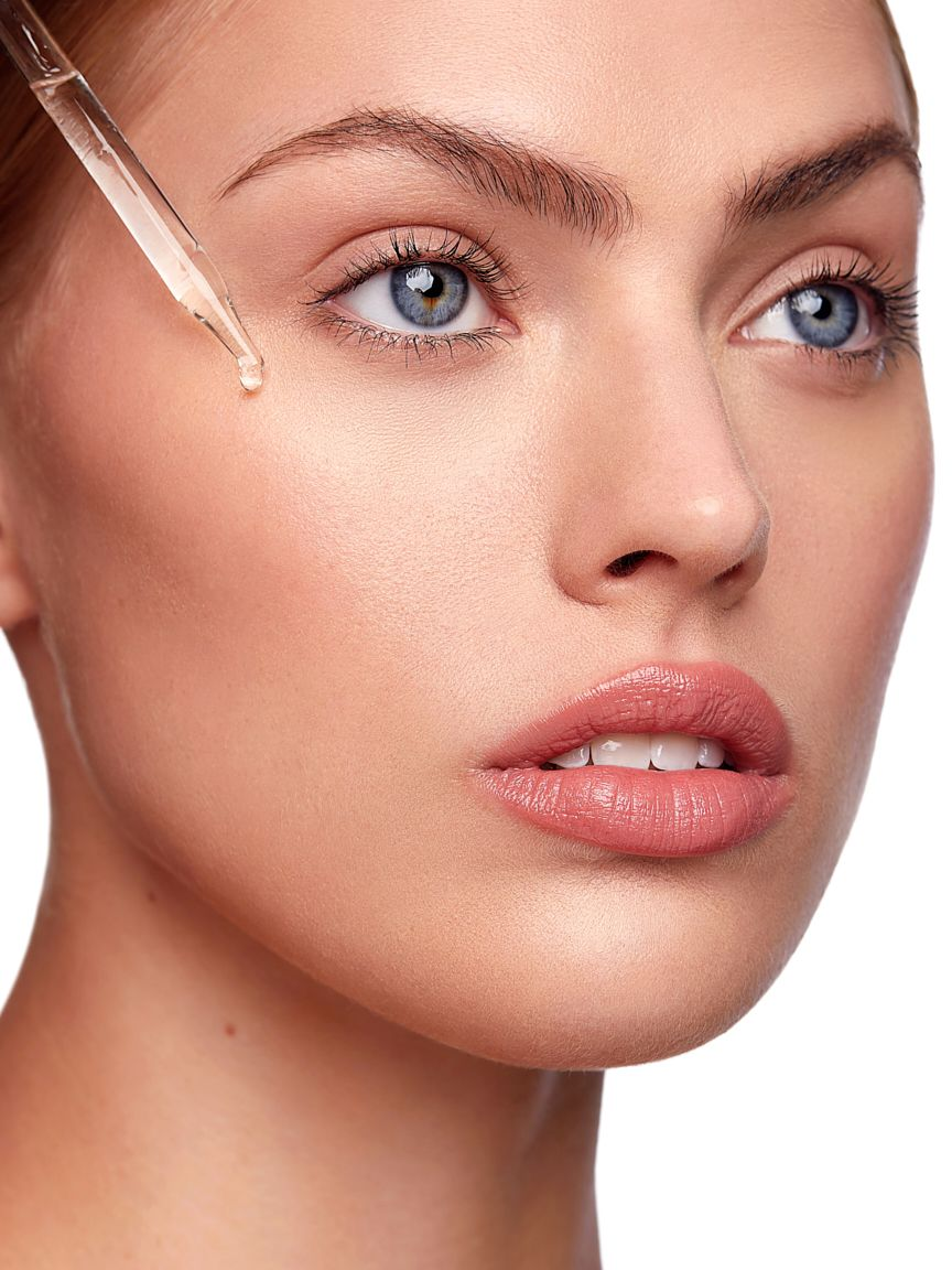 Kate-Woodman-skincare-model-dripping-oil-on-face.jpg