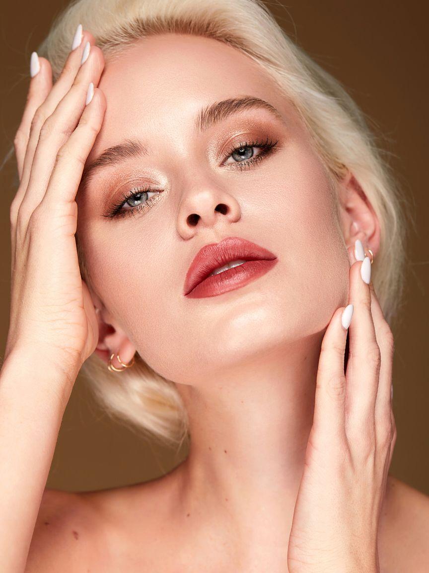 Gabriella-pawelek-touches-face-wearing-makeup.jpg