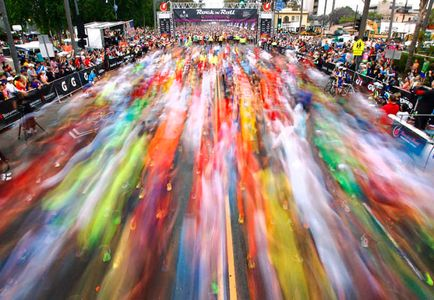 A blur of runners start the San Diego Rock 'n' Roll Marathon down 6th Ave. near Balboa Park.