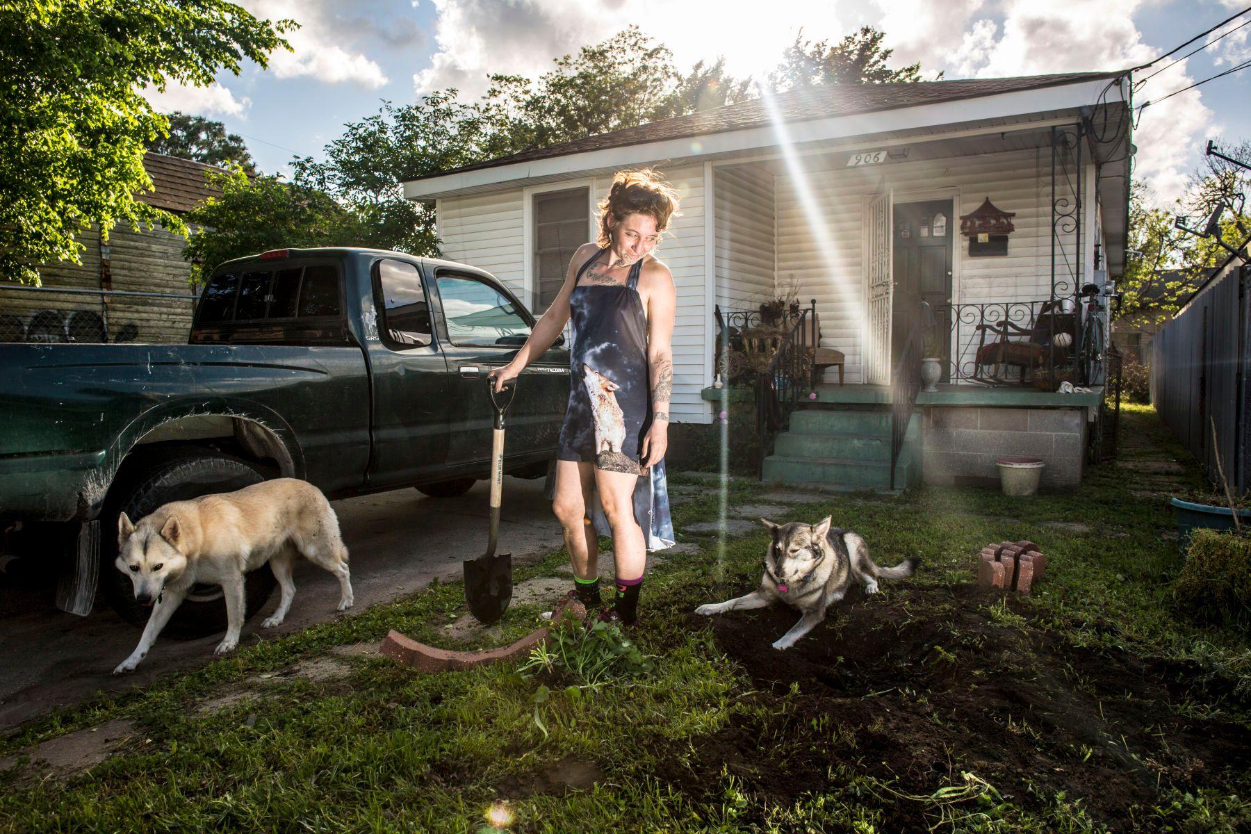 Phonix Carey and Katrina Swanson(with shovel) replanting a bush