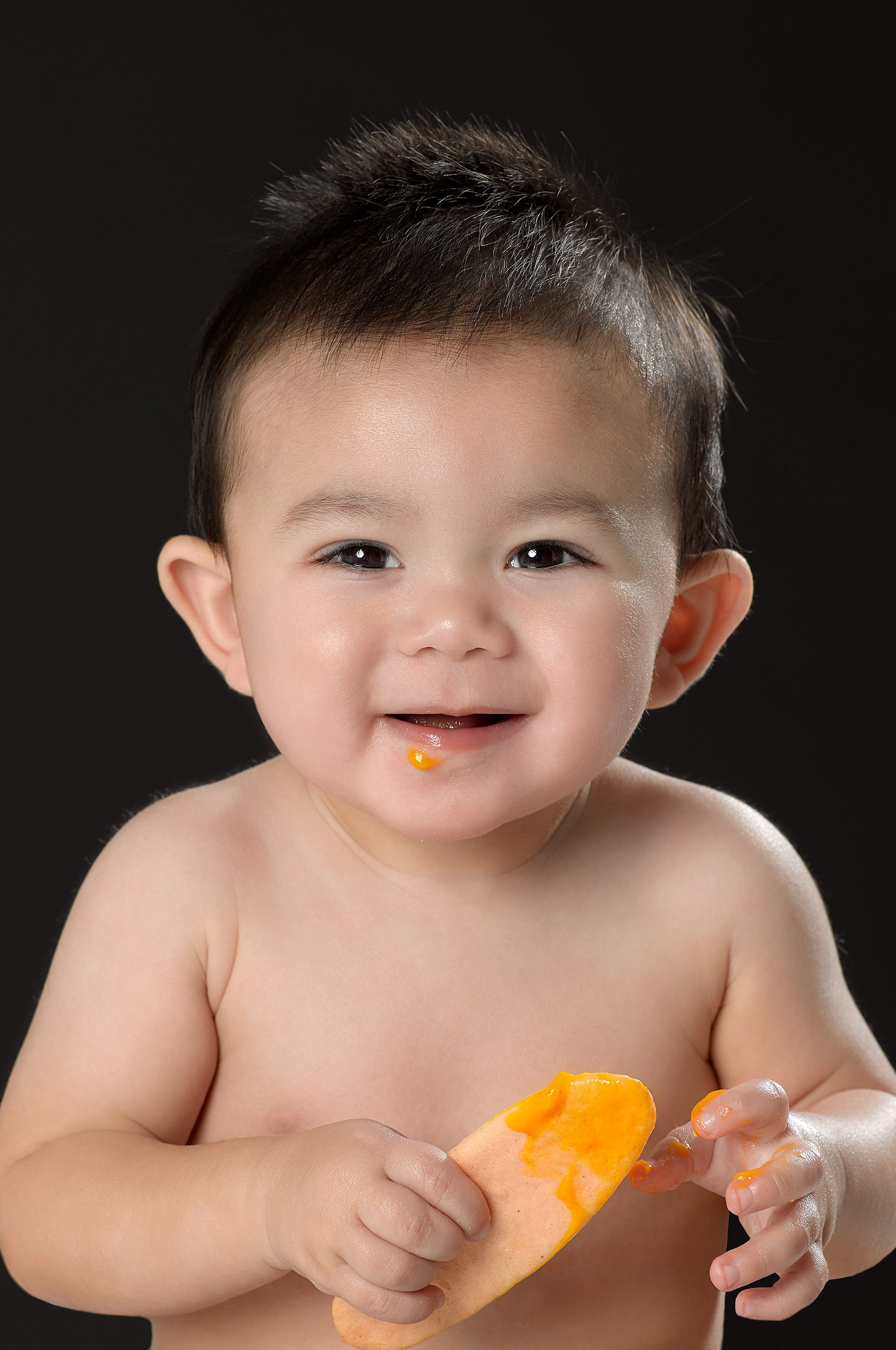 Asian baby with cracker