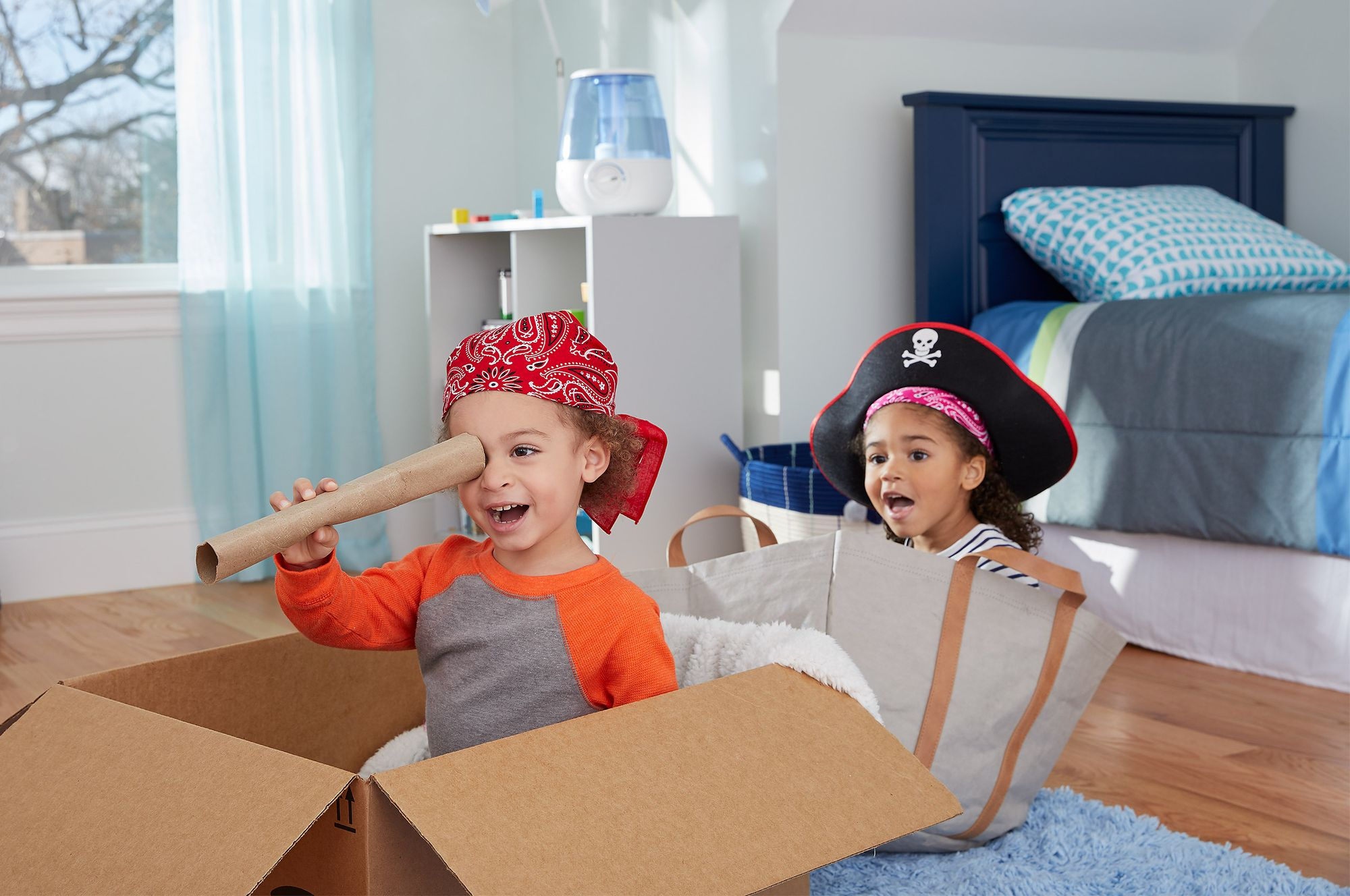 2 kids pretending to be pirates