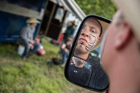 Boy Preparing For  Rodeo Applying Face Paint