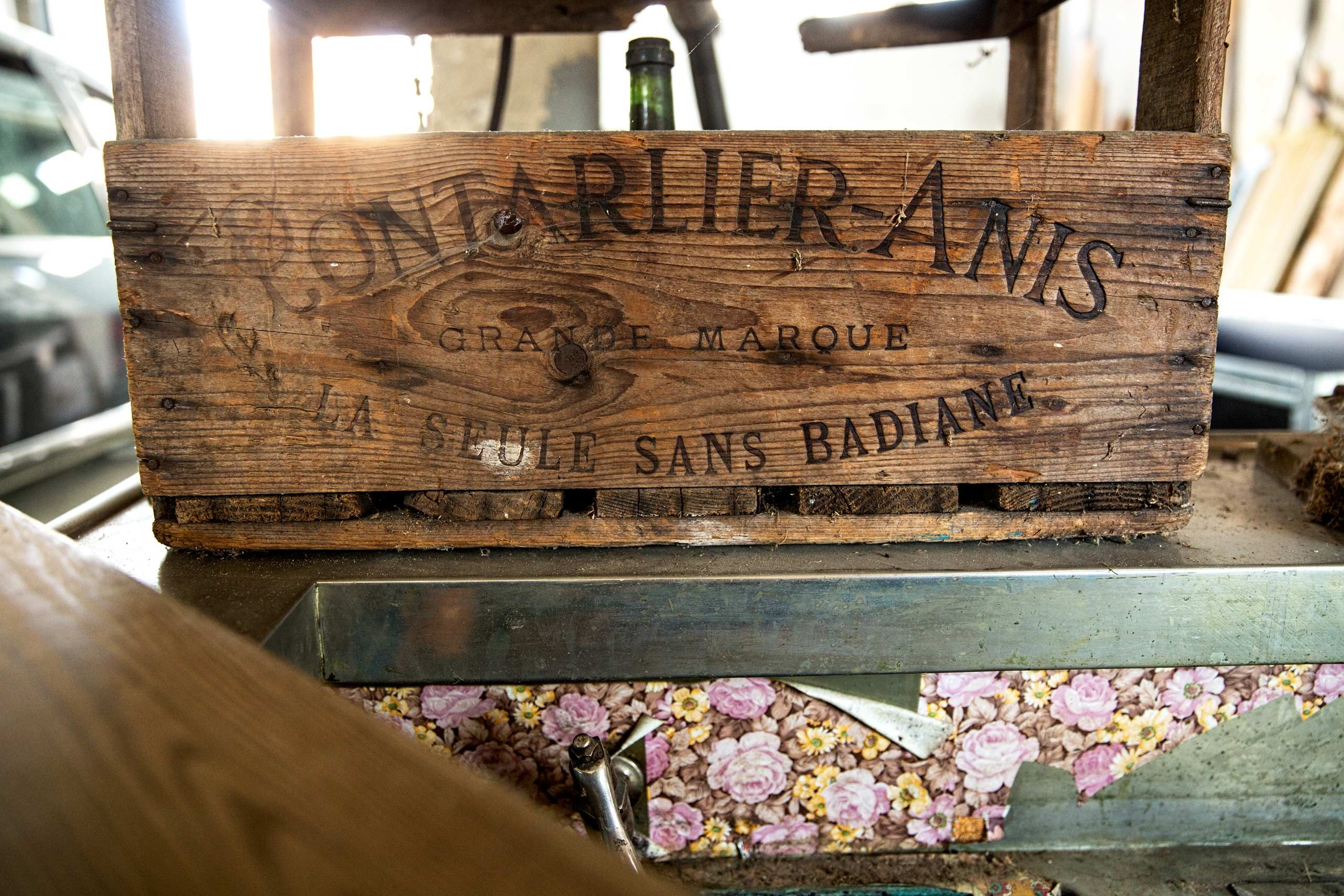 An Old Wooden Sign at Distillery Armand GUY
