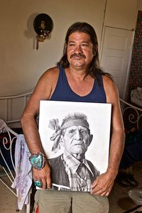 Native American Man Holding a Photograph