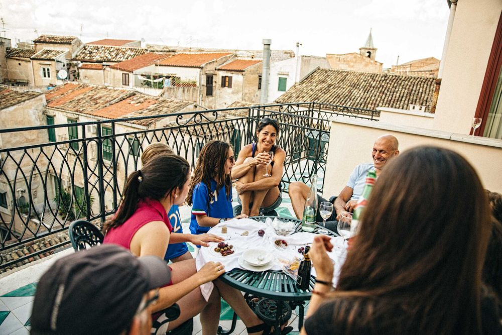 Family Eating ON a Balcony