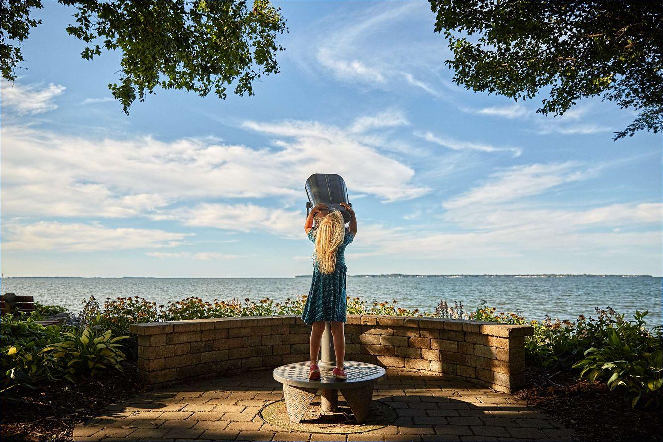 Girl Gazing Through Binoculars