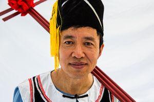 Portrait of a Man Holding a Cross