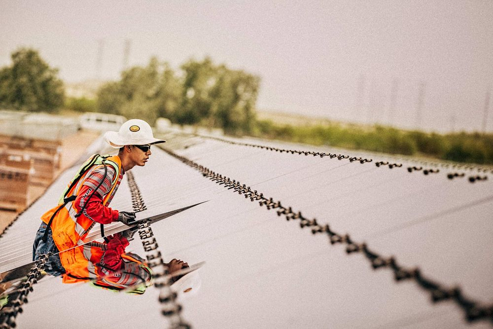 Worker Installing a Solar Panel