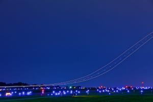 Streaks of Airplanes in a Night Sky