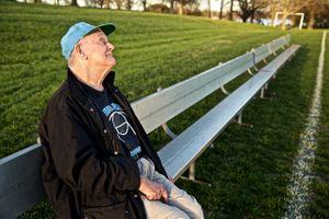 Blind Senior Citizen Sitting on a Bench