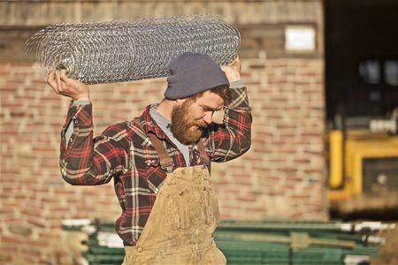 Farmer Carrying Chicken Wire