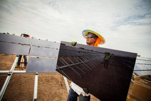 Worker Holding a Solar Panel