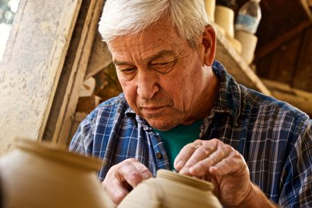 Older Man Working on a Pottery Wheel