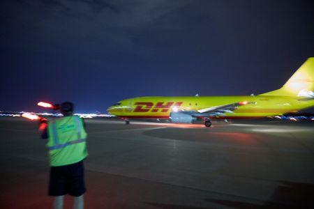 Air Marshal Singling Takeoff to a DHL Plane