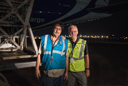 Environmental Portrait of Two Cargo Workers at Airport