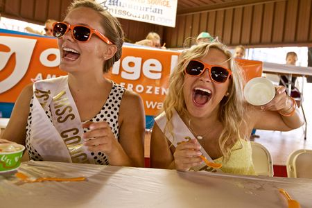 Two Girls Competing In a Ice Cream Eating Contest