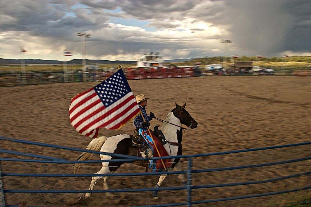 Rodeo Rider Holding an American Flag
