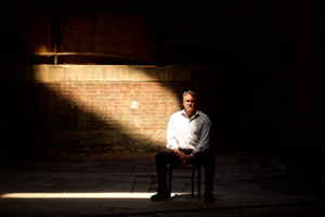 Dramatic Portrait of a Man In an Urban Environment