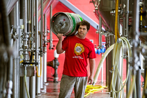 Brewmaster Holding a Keg of Beer