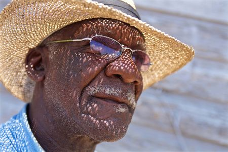 Photo of a Man in a Straw Hat
