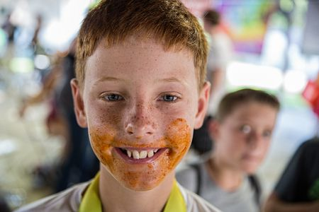 Boy With Chicken Wing Sauce On His Face After Eating Contest