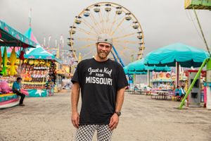 "Man At a Fair Wearing ""Just A Kid From Missouri"" T-Shirt"