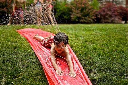 Boy on a Water Slide
