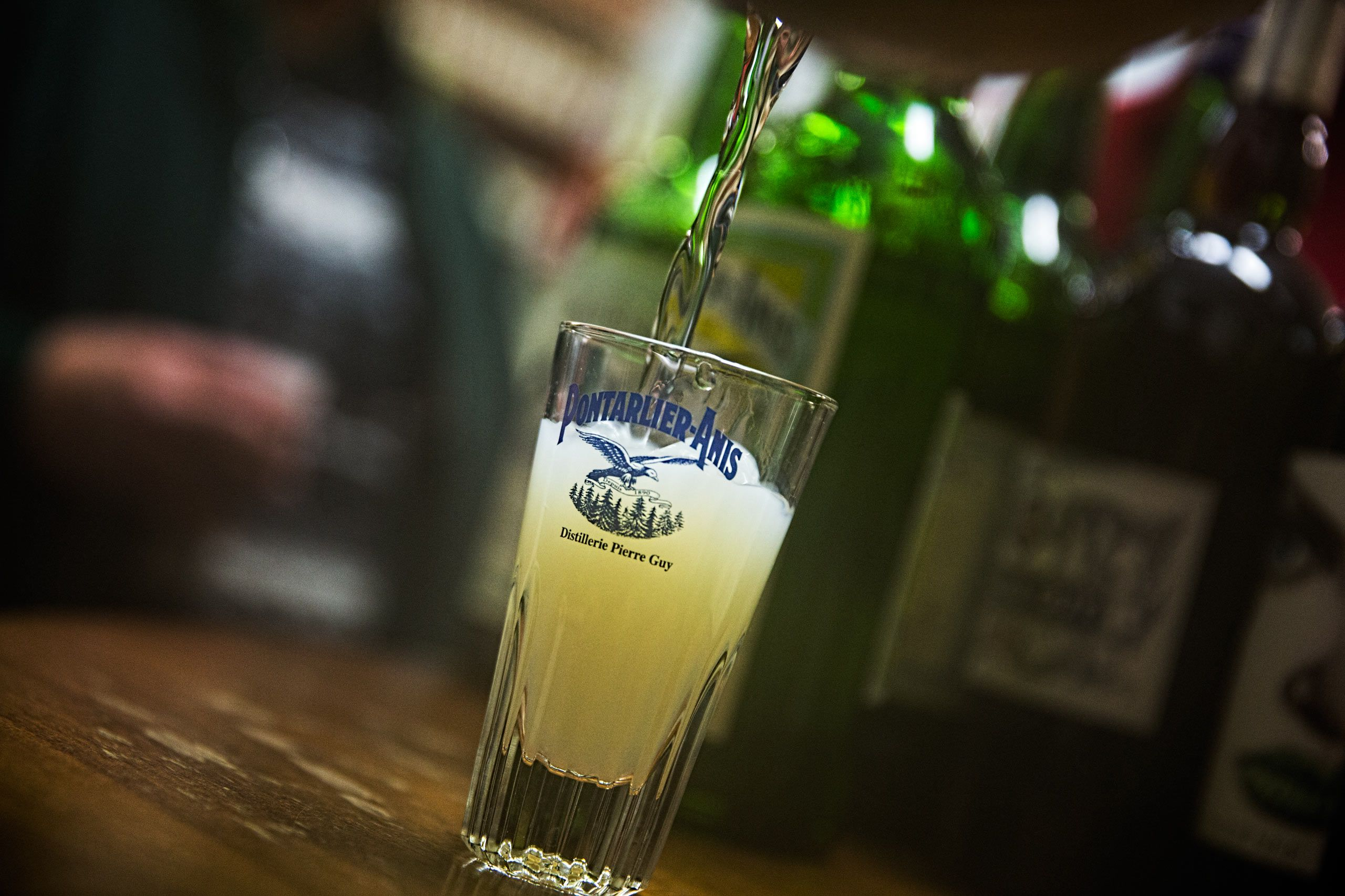 Absinthe Being Poured Into a Glass