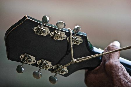 LC Ulmer Hand On Neck of a Guitar