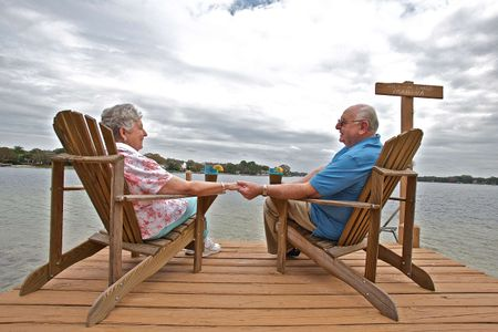 Retired Couple Sitting on a Dock