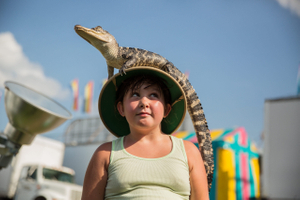 Girl With Alligator On Her Head