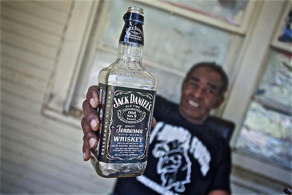 T Model Ford Holding a Bottle of Jack Daniels
