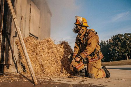 Fireman Prepares to Enter a Burning Structure