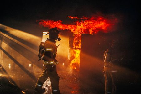 Firman Walks Through a Burning Building With Flames