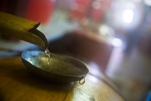 Absinthe Flowing into a Wooden Barrel
