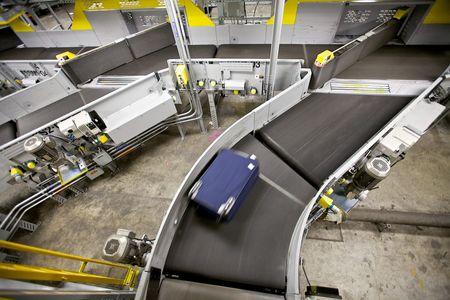 Luggage on a Conveyor Belt