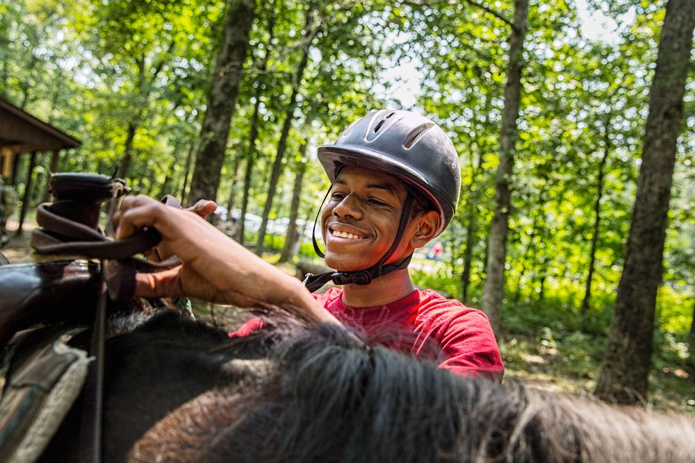 Boy Getting Ready to Ride a Horse