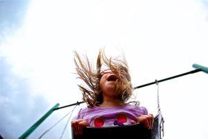 Girl Swinging, Shot form Below